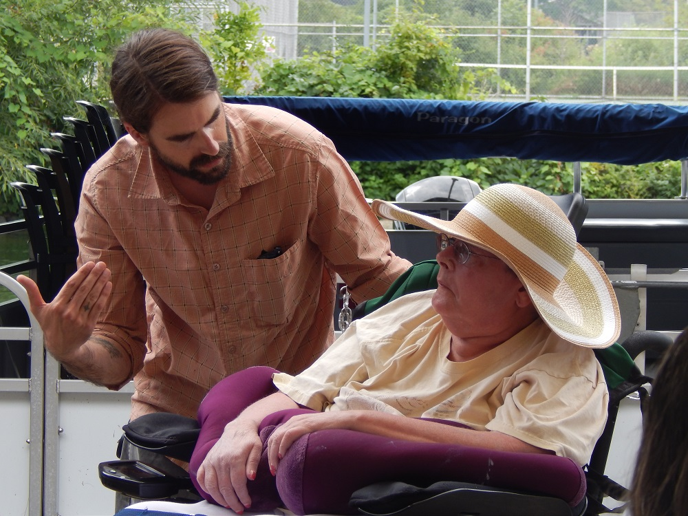 woman in wheelchair and male caregiver